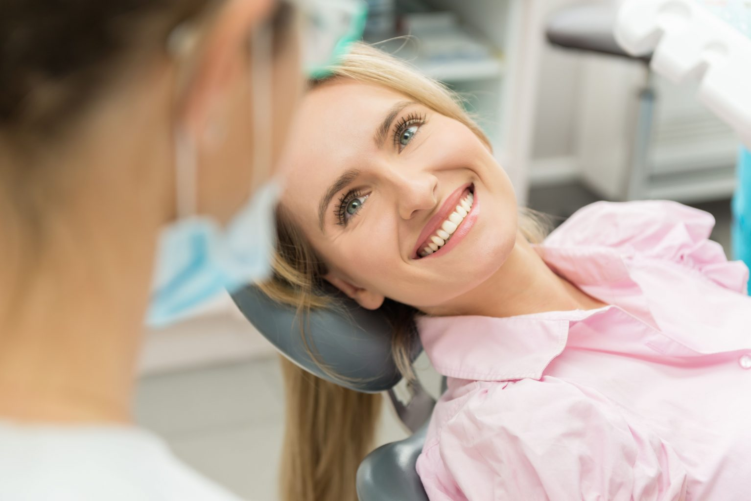 Woman Smiling At Doctor